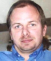 A photo of homicide victim Duane Dettinger, taken in 2006 at neighbor Anita Hartman's wedding.