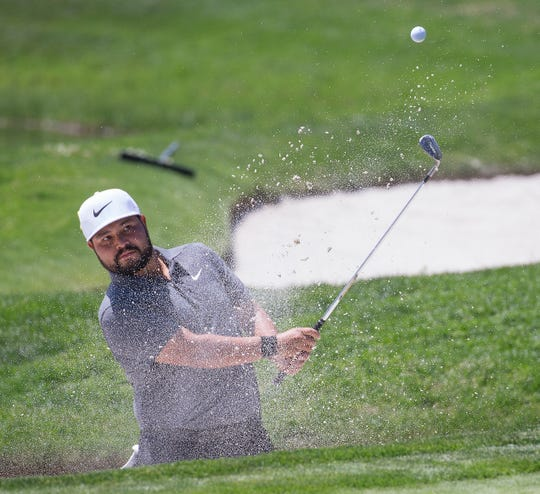 J.J. Spaun hits out of a bunker on the first hole during the Barracuda Championship at Montreux Golf Course on Aug. 5, 2018.