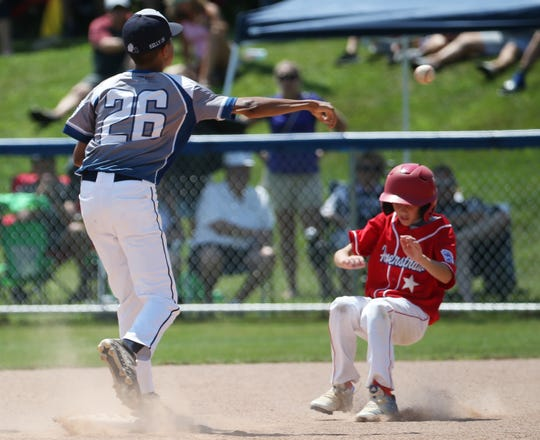 Webster's Jack Kelly (26) makes this double play at second to first against Haverstraw at State Little League Championships in Penfield, NY.