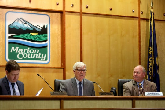 Marion County Commissioners Colm Willis, from left, Kevin Cameron and Sam Brentano lead a meeting to appoint a State Representative for House District 19 to replace Denyc Boles in Salem on July 23, 2019. Raquel Moore-Green was selected to fill the seat.