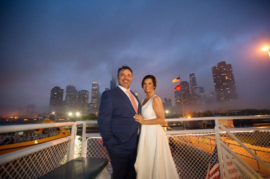 Times Sports Reporter Roy Lang III and Real Estate Agent Christi Johnson, wearing a Calvin Klein dress, on the boat where they were married in Chicago - with skyline in the background.