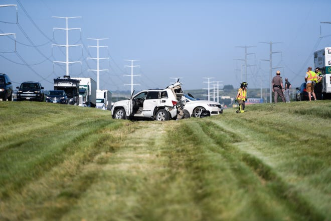 Emergency services respond to a four vehicle crash on the east bound lane of Interstate 90, Tuesday, July 23, in Brandon, S.D.