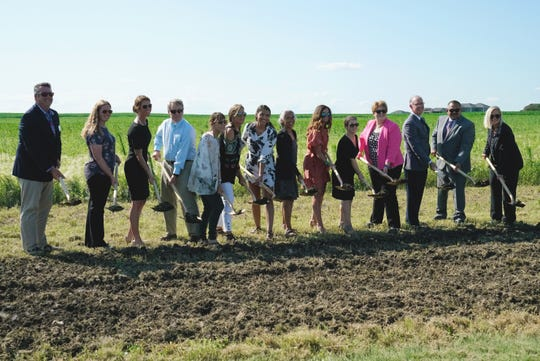 Sioux Falls School district officials, community leaders and family members of former U.S. representative Ben Reifel break ground Monday, July 22, 2019, on the city's newest middle school, named in his honor.
