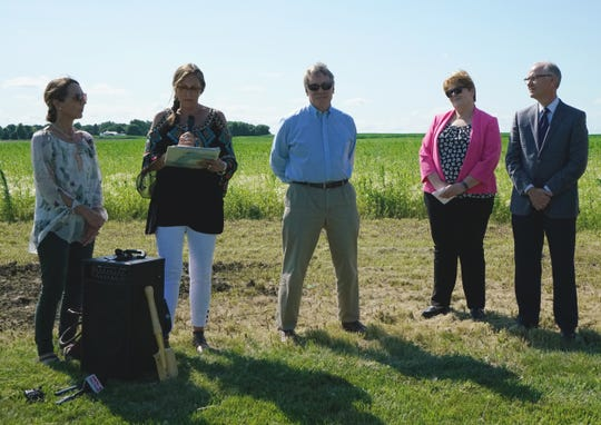 Lisa Moss, the granddaughter (center left) of former congressman Ben Reifel, shares memories of her grandfather with two other family members at the groundbreaking Monday, July 22, 2019, for a new middle school named in Reifel's honor. Betty Oldenkamp, a Sioux Falls Development Foundation board member, and Superintendent Brian Maher (far right), look on.