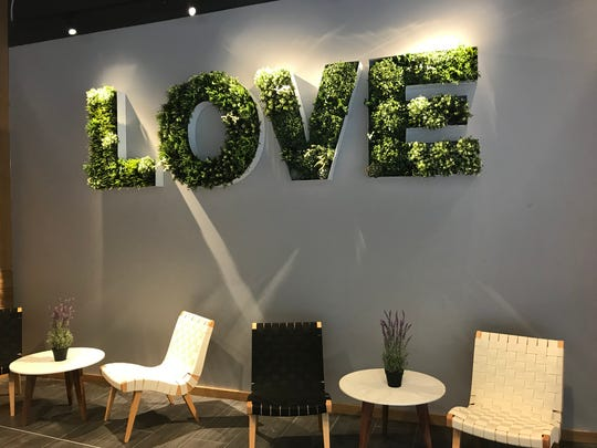 "Agua Fresh owner Sinan Taskin hopes this ""love"" plant decoration encourages customers to take photos and tag his business on Instagram."
