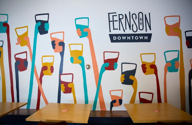 The colorful mural designed by Evan Richards, marketing director of Fernson Brewing Company, expands across an entire wall in the Fernson Downtown location.