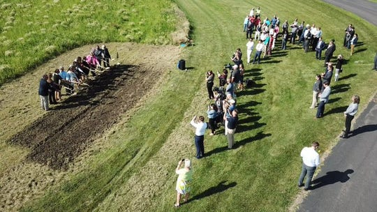A drone image shows Sioux Falls School district officials, community leaders and family members of former U.S. representative Ben Reifel break ground Monday, July 22, 2019, on the city's newest middle school, named in his honor as a crowd looks on. The school, located northwestern Sioux Falls, will open in fall 2021.