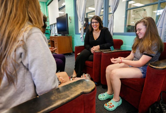Brandy Harris, center, chief executive officer of the Boys & Girls Clubs of Springfield, laughs while talking with Samantha O'Brien, 13, right, Kenzie Roesener, 13, left, and Miracle Dyer-Lacio, 14, obscured, at the Stalnaker Unit on Tuesday, July 23, 2019, in Springfield, Mo.