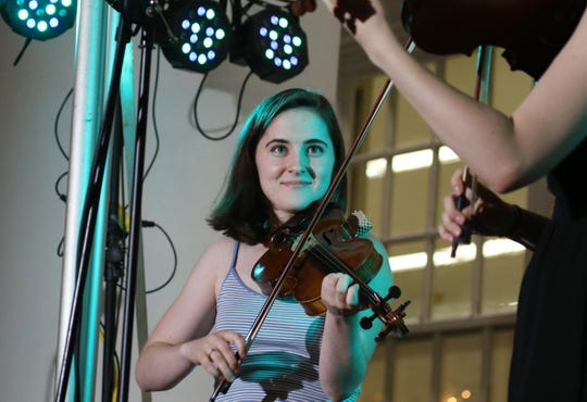 Heifetz Institute summer student Isabella Gorman plays a fiddle tune with Kitty Amaral at the Heifetz Hootenanny concert on Mary Baldwin University's campus on Saturday, July 20, 2019.