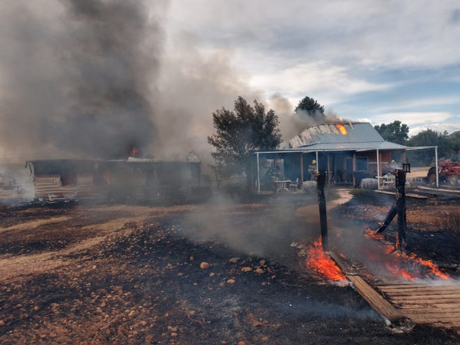 A wildfire burned down one home and threatened som 30 others in the town of Paragonah, north of Cedar City, on Monday.