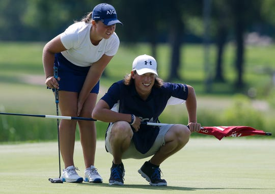 Bay Port High School's Jo Baranczyk and her caddie, brother Jed Baranczyk, share a laugh as they read her putt on the 11th green during the second round of the U.S. Girls Junior Championship on Tuesday at SentryWorld in Stevens Point.