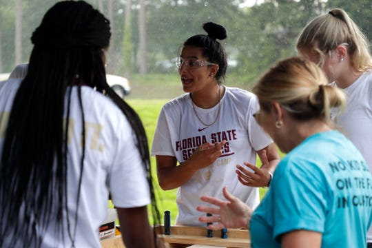 Izabela Nicoletti, a member of the Florida State women's basketball team, works with her teammates to build beds for children in the Big Bend. FSU women's basketball teamed up with Texas Roadhouse and other volunteers to complete the project Tuesday, July 23, 2019.