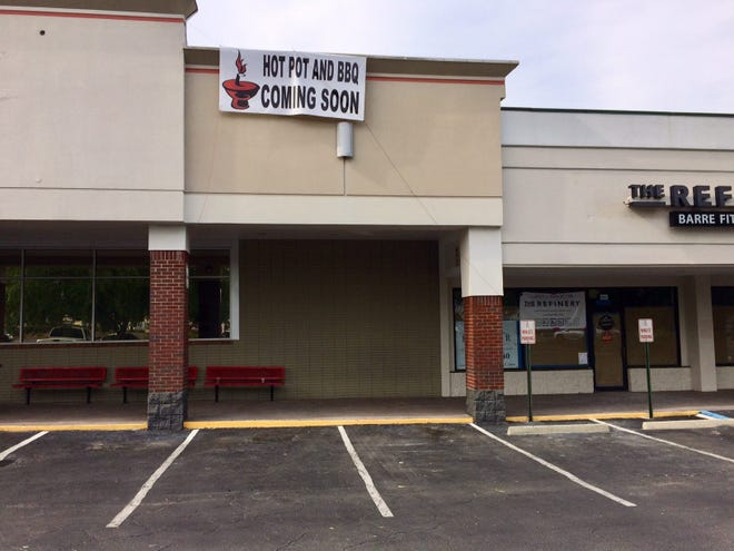 """A """"Hot Pot and BBQ coming soon"""" sign has been up in a shopping center on Thomasville Road."""