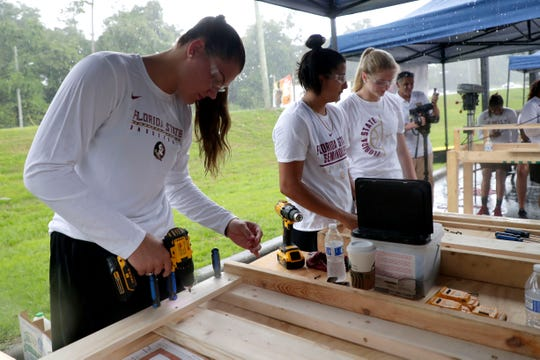 River Baldwin, a member of the Florida State women's basketball team, works alongside her teammates to build bunk beds for children in the Big Bend. FSU women's basketball teamed up with Texas Roadhouse and other volunteers to complete the project Tuesday, July 23, 2019.