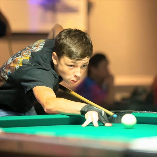 Peyton Green of Tallahassee cues up a shot. He recently competed in the American Poolplayers Association Junior Championships in St. Louis.