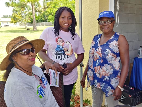 Marie Josie Glemaud, left, Jata Moise, and Marie Myrtil at the moving-in celebration for the Alzimé-Moise family at their St. Lucie County Habitat for Humanity home in Port St. Lucie.