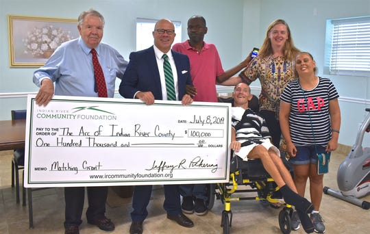 The Arc Chairman of the Board Reese Brackins, left, with Indian RIver Community Foundation CEO Jeff Pickering and The Arc CEO Heather Dales, with clients Steve, Craig and Christy. The Community Foundation awarded $100,000 to The Arc of Indian River County as part of a $1.1 million effort to build a new Fragile Group Home.