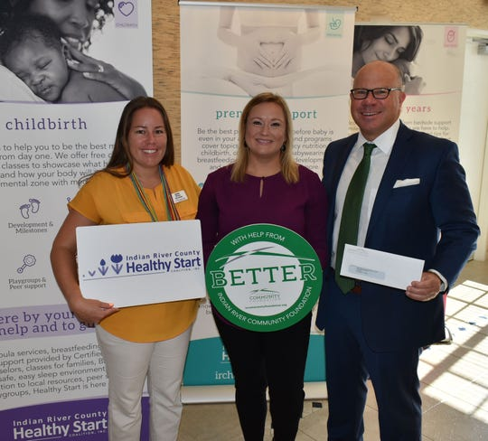 Ashley Watson, left, and Elisabeth Bublitz of Indian River County Healthy Start Coalition with Jeff Pickering of Indian River Community Foundation with a $25,000 check for the Healthy Families Program.