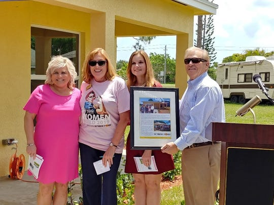 Kim Baxter, left, Melissa Winstead, Rebecca Lassiter and Elton Wetteland attend the St. Lucie Habitat for Humanity home dedication in Port St. Lucie.