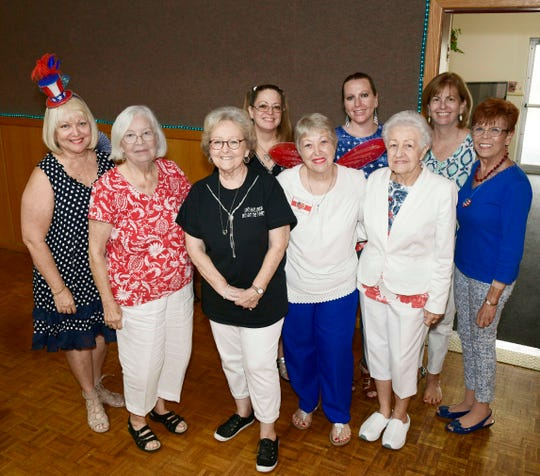 Ladies of Jewelia past and present, from left, Sydney Liebman, Cris Adams, Pat Alley, Tammy Crandell, Tena Sigmon, Jennifer Wiggins, Gerri Elliott, Jennifer Doad and Linda Evans at the All American Bingo benefit for HANDS of St. Lucie County, a Volunteers in Medicine Clinic.