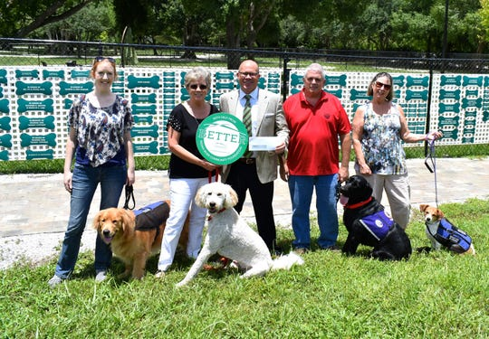 Indian River Community Foundation recently gave $25,000 to Dogs for Life for the Veteran Service Dog Training Program. Community Foundation CEO Jeff Pickering, third from left, is pictured with Dogs for Life representatives Harriet McCarthy, Shelly Ferger, Mark Poziomek and Judi Ricard with Rufus, Bentley 2, Ranger and Fitz.