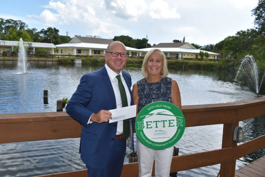 Jeff Pickering, left, CEO of Indian River Community Foundation, presents Linda Colontrelle, president of the St. Francis Manor Board of Directors, with $15,000 to pay for the replacement of original windows with energy-efficient impact windows at the 45-year-old facility which serves low-income seniors.