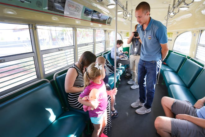 Locomotives goalkeeper Logan Ketterer asks Layla Brooker if he can sign her jersey while they ride the El Paso Streetcar as part of the summer Streetcar Soccer Series Monday, July 22, in downtown El Paso.