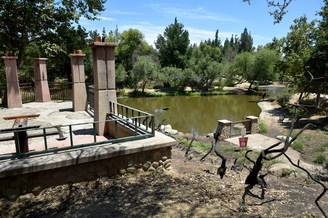 A burnt out picnic pavilion and shrubs show the aftermath of the Woolsey Fire that caused damage throughout Oak Canyon Community Park in November. After several months, repairs may be on the way, but dozens of turtles that live in the pond need to be relocated in the next few weeks.