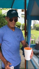 Mariano Rivera, 79, of Vineland, serves a fresh-shaved snow cone at his curbside business in the 400 block of  North East Avenue, Vineland, NJ.