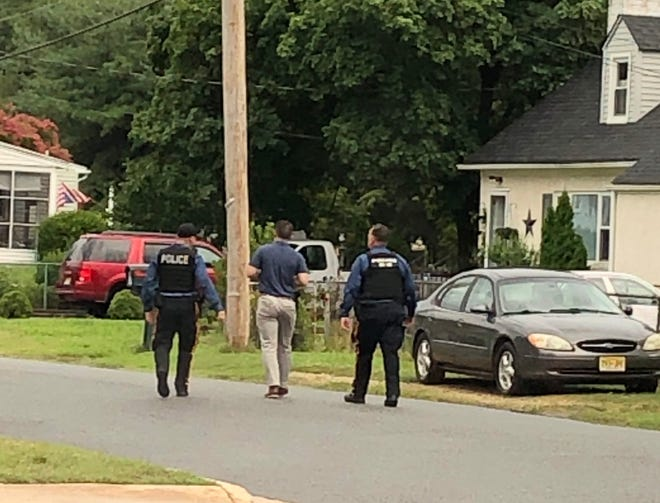Vineland Police searched the neighborhood along Rieck Terrace for evidence after an armed robbery at the Riggins Gas Station on South Main Road.  July 22, 2019.