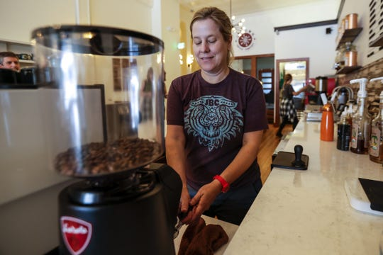 Co-owner Vicki Tracy in the process of making a cup of coffee July 17, 2019, at Uptown Coffee Company in Marshfield, Wis.