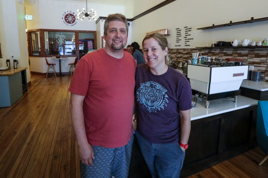 Owners John and Vicki Tracy pose for a photo July 17, 2019, at Uptown Coffee Company in Marshfield, Wis.