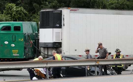 New York State Police along with Goldens Bridge and Croton Falls firefighters work at the scene of a crash involving cars and tractor trailers on southbound Interstate 684 in Goldens Bridge on July 23, 2019.