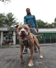 Ricardo Simon takes Tonka for a walk at Hi Tor Animal Care Center in Pomona on Tuesday, July 23, 2019.