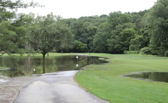 A collection pond overflows on the ninth hole at Maple Moor Golf Course in White Plains on Tuesday, July 23, 2019.
