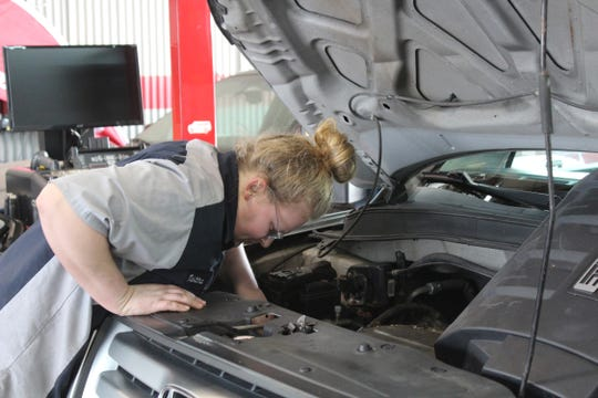 Tabitha Harris, a Sussex Technical High School student, works in  at an auto mechanic's shop as part of the school's Career Capstone program.
