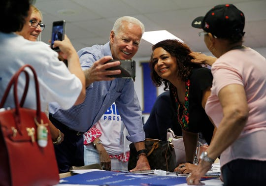 Former Vice President and Democratic presidential candidate Joe Biden takes a selfie with a supporter during a campaign event at an electrical workers union hall Saturday, July 20, 2019, in Las Vegas. (AP Photo/John Locher)