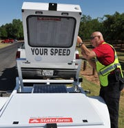 Wichita Falls police Sentinel, Gary Tumey demonstrates one his department's newest tools, a speed monitor, donated by State Farm.