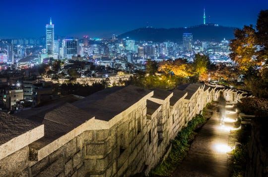 A view of Seoul at night from the City Wall, which dates back to 1396.