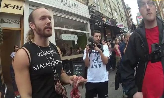 An image of Gatis Lagzdins holding the dead squirrel before eating it at the Soho Vegan Food Market on March 30.