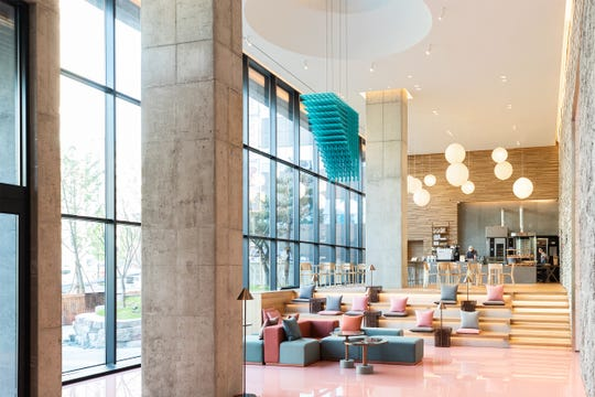 The pastel colored lobby and Tartine bakery in RYSE hotel's lobby is a popular hangout for both tourists and locals in Seoul.