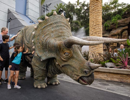 "Juliet the Triceratops meets guests at ""Jurassic Park - The Ride."""