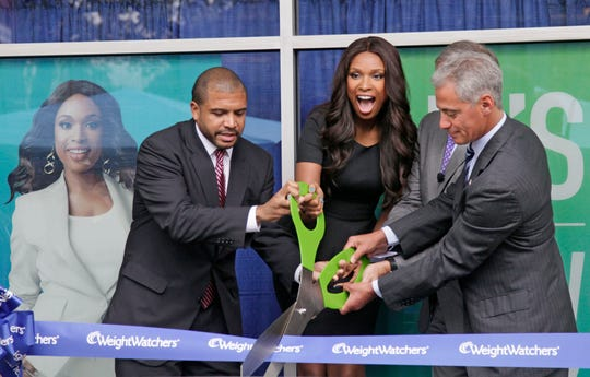 "Chicago Alderman Will Burns, left, Grammy and Oscar-winning singer and actress Jennifer Hudson, Dave Burwick, President, Weight Watchers North America, and Chicago Mayor Rahm Emanuel take part in a ribbon cutting at the opening of ""The Weight Watchers Jennifer Hudson Center,""  Tuesday, Sept. 27, 2011, in Chicago."