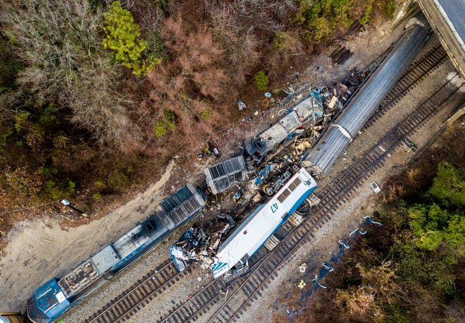 This Feb. 4, 2018, file photo shows an aerial view of the site of a fatal train crash between an Amtrak train, bottom right, and a CSX freight train, top left, in Cayce, S.C. Federal officials are meeting to discuss what caused an Amtrak train to divert on to a side track in South Carolina last year and slam into a parked train, killing two crew members and injuring more than 100 passengers.