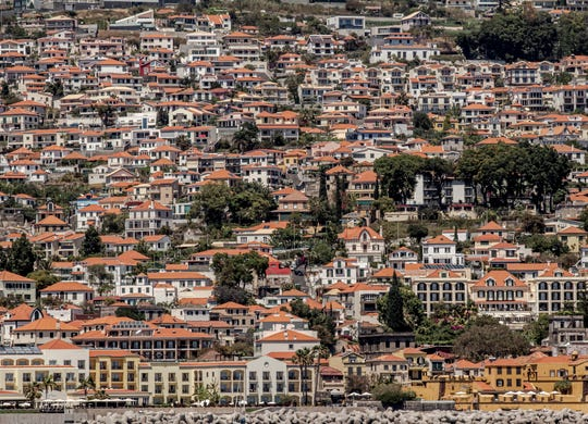 A view of Funchal from the sea: The first settlers arriving in 1425 came from the north of Portugal. In the 17th century, the wine industry began to bear fruit with fortified wines, which gave the island a hot commodity to trade. Cultural heritage includes year-round festivals and events.