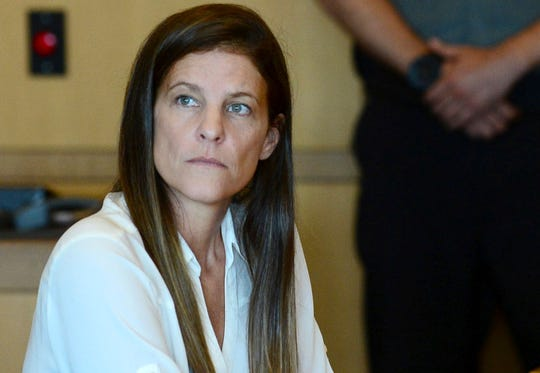 In this June 28, 2019, file photo, Michelle Troconis attends a hearing in Stamford Superior Court in Stamford, Conn.