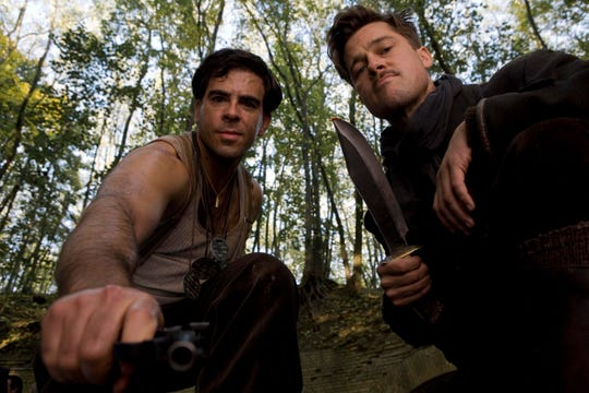 "Eli Roth (left) and Brad Pitt are Nazi hunters with a dangerous mission in ""Inglourious Basterds."""