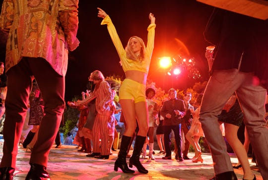 "Sharon Tate (Margot Robbie, center) lives the celebrity high life in ""Once Upon A Time in Hollywood."""