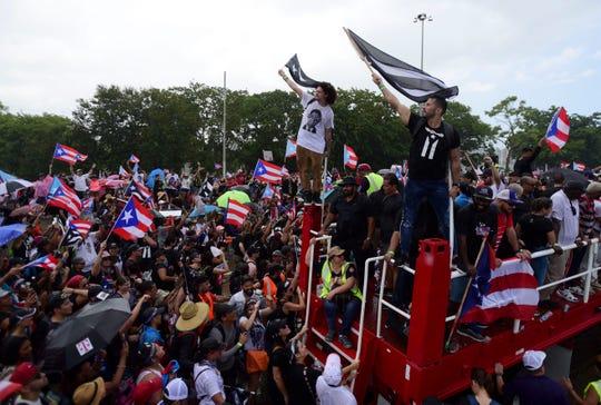 Demonstrators march on Las Americas highway.