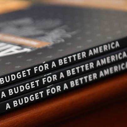Copies of President Donald Trump's proposed budget on March 11, 2019.